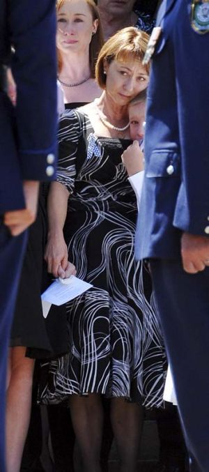Mourning ... Dave Rixon's wife Fiona and their youngest son at his funeral.