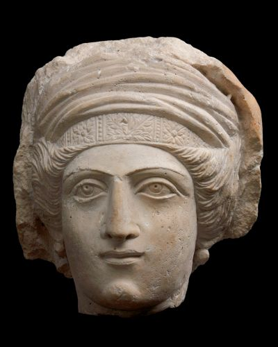 ''Funerary relief: woman in a tall headdress (fragment)''; Tanagra, 3rd century BC; clay, traces of white slip and ...