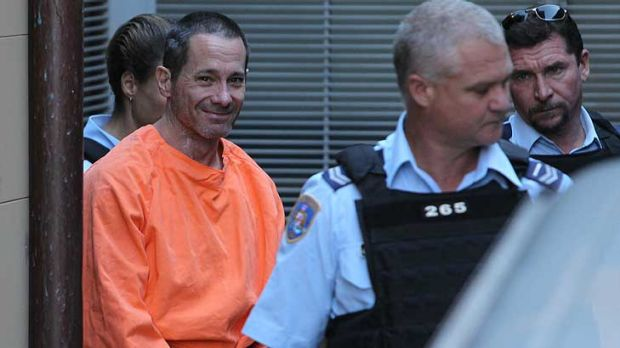Smiling assassin ... Walter Marsh leaves court after receiving a life sentence for murder.