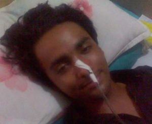 Muneeb Ahmed, 18, who was seriously injured by the bullet that killed his grandfather.