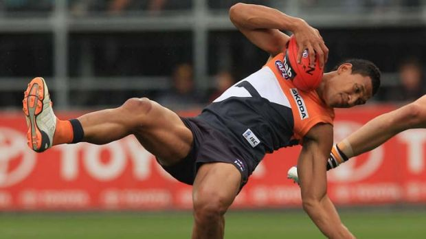 Sweet success ... GWS Giants's Israel Folau heads for the ground in yesterday's match.