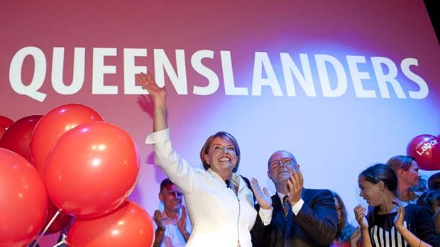 Anna Bligh and partner Greg Withers surrounded by children with balloons at the official Labor Campaign Launch in Brisbane.