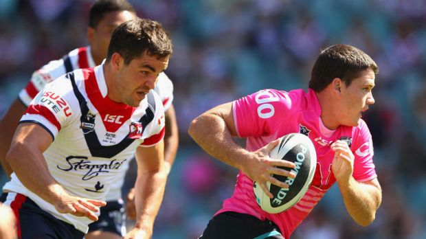 Lachlan Coote of the Panthers scoots away from the Sydney Roosters defence.