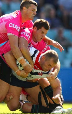 Tag team effort … the Roosters' Martin Kennedy is held by three Panthers yesterday.