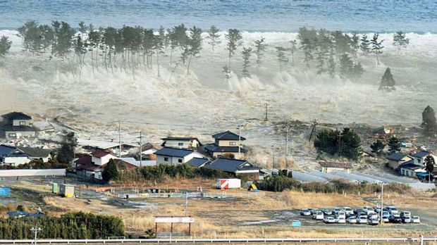 The tsunami-devastated Natori city in Miyagi prefecture is seen in these images taken March 11, 2011 (top) and March 1, 2012.