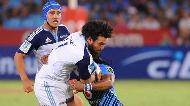 Rene Ranger of the Blues is tackled by Akona Ndungane of the Bulls during Saturday's Super Rugby match.