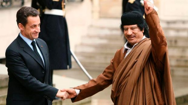 French President Nicolas Sarkozy with former Libyan leader Muammar Gaddafi during the late dictator's visit to Paris in 2007.