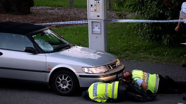 Police survey the accident scene in South Yarra.