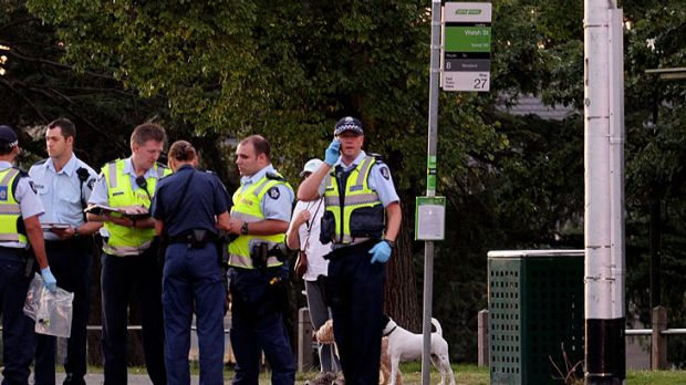 Officers gather evidence on Toorak Road.