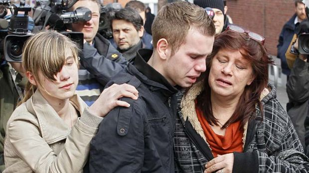Tragedy ... relatives, parents and teachers mourn the victims of the crash.