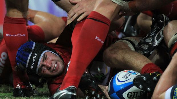 Liam Gill of the Reds at the bottom of the breakdown against the Rebels.