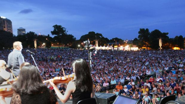 Outsiders ... a huge crowd attends Symphony in The Domain last year.