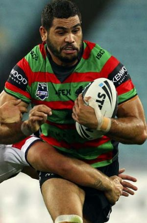 Frustrated … Greg Inglis is tackled against the Roosters.