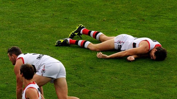 Down and out: Saint Lenny Hayes lies unconscious after being accidentally  kneed in the head while trying to tackle  ...