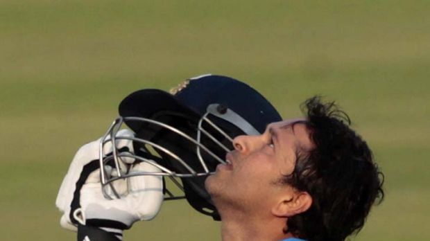 Finally ... India's Sachin Tendulkar celebrates after he scored his 100th international century.