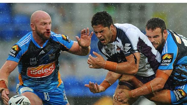 Jesse Bromwich of the Storm loses the ball in the tackle.