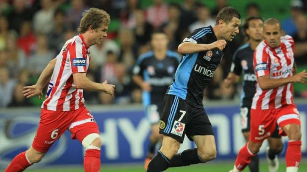 One more chance … Sydney FC's Brett Emerton takes the ball up against Melbourne Heart last night.