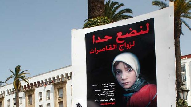 Women hold posters of victims as they protest in support of Amina Filali who committed suicide last week, in front  ...