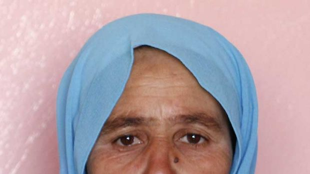 Zohra Filali the mother of rape victim, Amina Filali who committed suicide last week, shows a picture of her daughter.