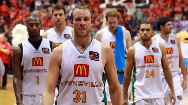 The Townsville Crocodiles leave the court after being defeated by the Perth Wildcats.