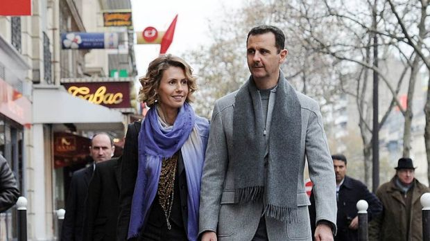 Kept 'beautiful aides' ... Bashar al-Assad takes a stroll around Paris with his wife Asma in 2010.