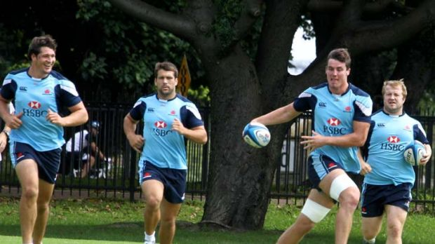 Backs against the wall … the Waratahs' back line looked jovial at training yesterday but it's very serious for the ...