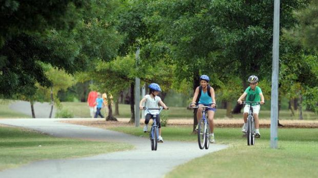 File photo of cyclists riding on the path around Lake Tuggeranong.
