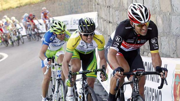 Fabian Cancellara  of Switzerland, Simon Gerrans of Australia and Vincenzo Nibali power up a climb in the final ...