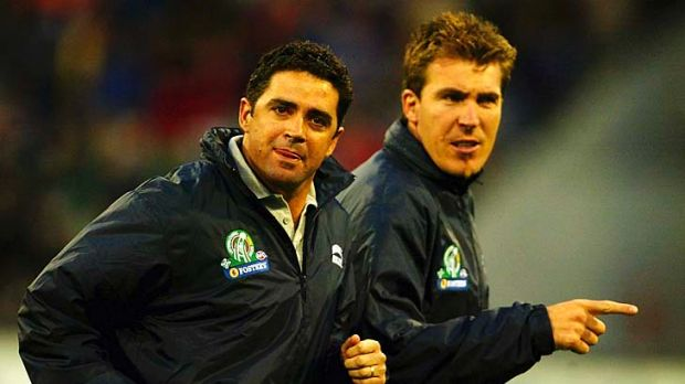 Garry Lyon, coach of the Australian team, and Jim Stynes leave the ground during the second match of the International ...