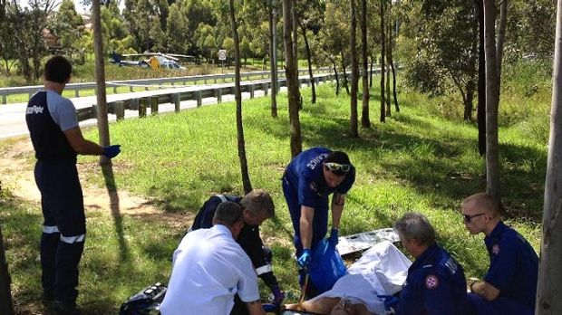 Paramedics and CareFlight doctors treat one of the men shot in Miller this afternoon.