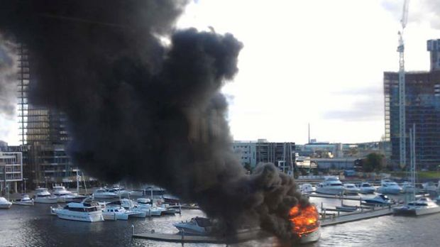 The boat on fire at Docklands.