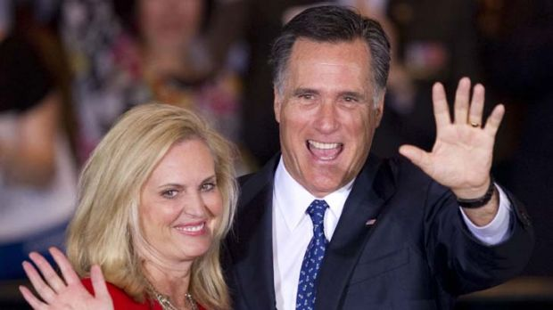 Glad hands ... a more relaxed Mitt Romney and wife, Ann, celebrate victory at the Illinois primary night in Schaumburg.