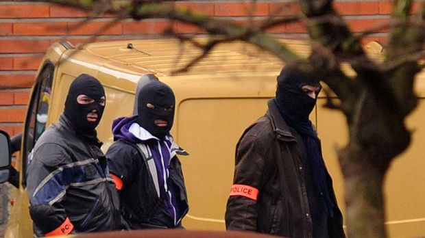 Siege  ... French police are seen near the suspect's apartment.