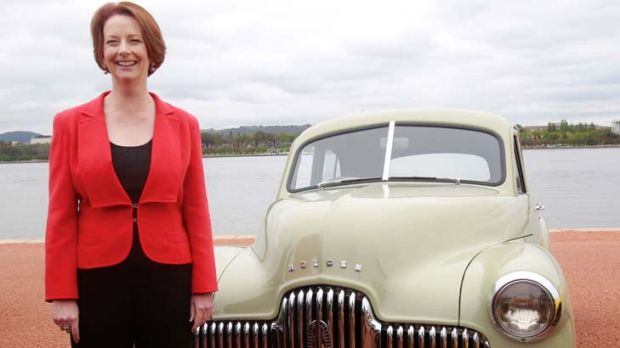 Australia's own Prime Minister ... Julia Gillard, like Ben Chifley in 1948, poses with the first Holden off the assembly ...