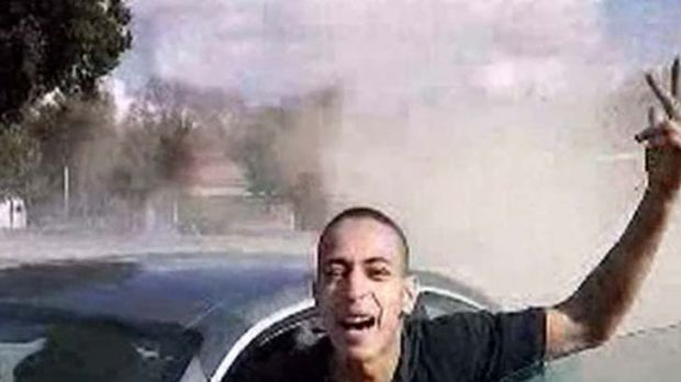 Two faces ... France 2 television aired this image claiming it to be of the suspected Toulouse gunman, Mohammed Merah, ...