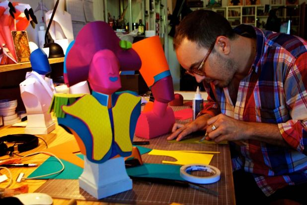 Benja Harney at work on his busts of famous figures in history.