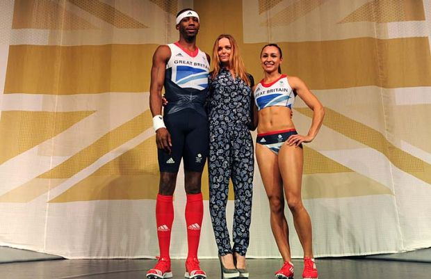 British athletes, triple jumper Phillips Idowu (L) and heptathlete Jessica Ennis (R) pose with designer Stella McCartney ...