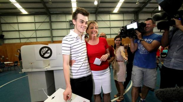 """Tough day"" ... Anna Bligh casts her vote with son Oliver."