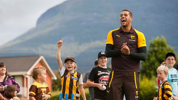 King of the kids: Lance Franklin builds bridges during a community camp in Hobart earlier this year.