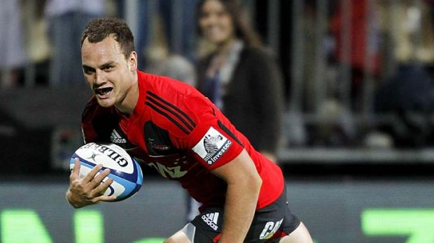 Israel Dagg of the Crusaders runs in to score the match-winning try.