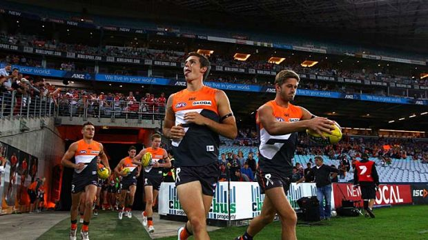 Here we come: Phil Davis and Callan Ward lead the Giants onto the ground last night.