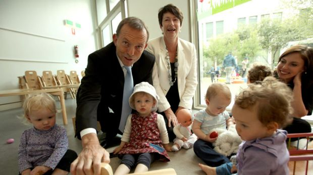 Father figure: Tony Abbott, with wife Margie, meets children at the Capital Hill Early Childhood Centre at Parliament House.