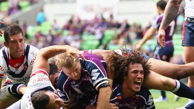 Cook your chooks ... the Storm's Kevin Proctor celebrates scoring a try against the Roosters.