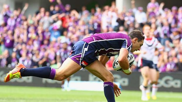 Stooping to conquer... Billy Slater scores again.
