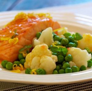 Grilled Atlantic salmon with cauliflower, peas and citrus sauce.