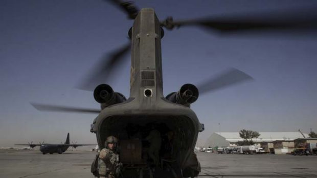 An air crewman from an Australian Army chinook, based at Kandahar Airfield, organises the pick-up of a load during a ...