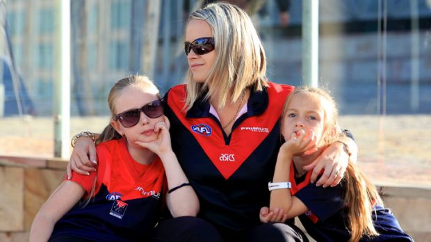 Demons fans begin to gather at Federation Square ahead of Jim Styne's funeral at St Paul's Cathedral.