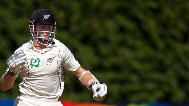 Kane Williamson loses his bat as he darts through for a sharp single on the final day of the third Test at the Basin ...