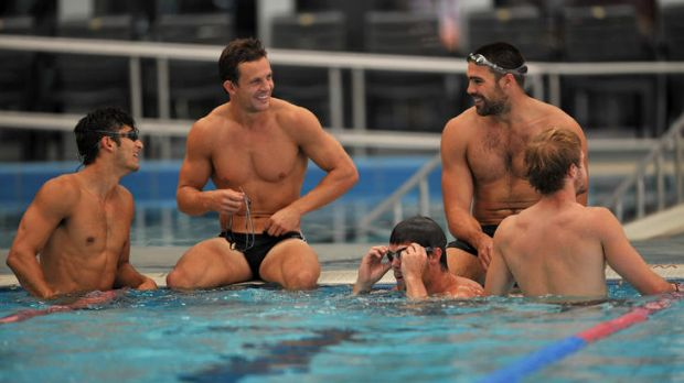 Collingwood players Sharrod Wellingham, Luke Ball and Chris Dawes take a dip during a community camp in Wangaratta.