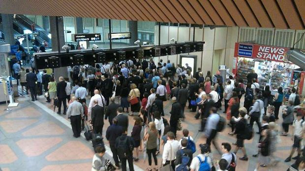 Commuters faced long queues just trying to get through the barriers at Flagstaff station.
